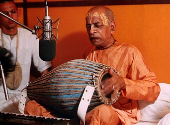 Prabhupada Chanting his rounds, Singing Bhajans, and Reading his Books