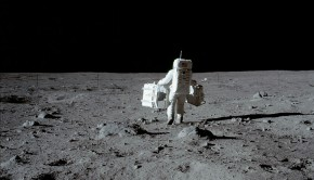 NASA astronaut carring equpment on the moon