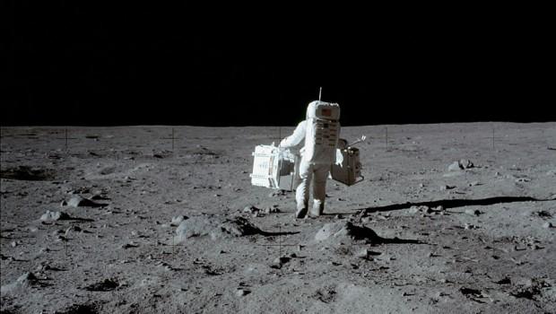 NASA astronaut carring equpment on the moon