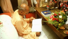Srila Prabhupada reads Sri Vyasa Puja Book at his desk