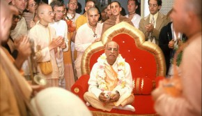 Srila Prabhupada surrounded by disciples having a kirtan