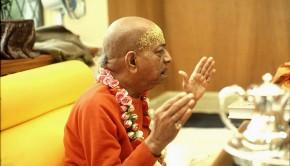Srila Prabhupada illustrates a point with his hands while preaching