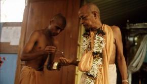 Srila Prabhupada taking carinamrta