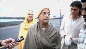 Srilla Prabhupada and disciples on road beside ocean