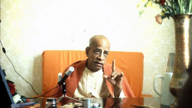 Srila Prabhupada preaching with finger pointing up