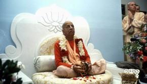 Srila Prabhupada playing kartals on white vyassasana