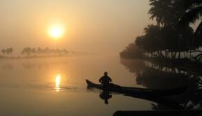 Indian Boatman in Boat on River