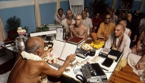 Srila Prabhupada Reading to Devotees in his room