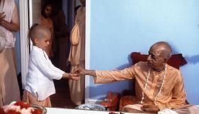 Srila Prabhupada distributing prasadam to a boy
