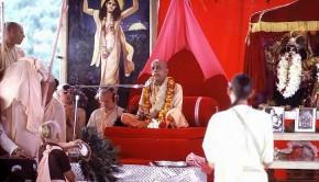 Srila Prabhupada sitting on Red Vyassasana Playing Kartals at New Vrindavan in pandal