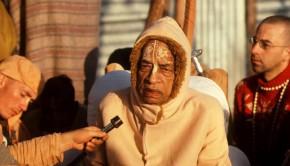 Prabhupada speaking into microphone