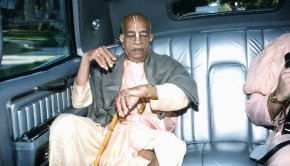 Srila Prabhupada looking at his watch in car
