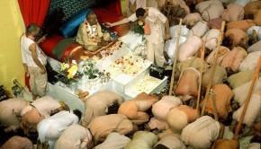 Devotees offer obeisances to Srila Prabhupada in Temple