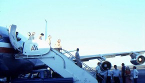 Prabhupada gets off an American Airlines Plane