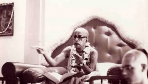 Srila Prabhupada animatedly illustrating a point during class