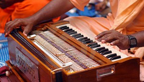krishna devotee playing harmonium-6438700