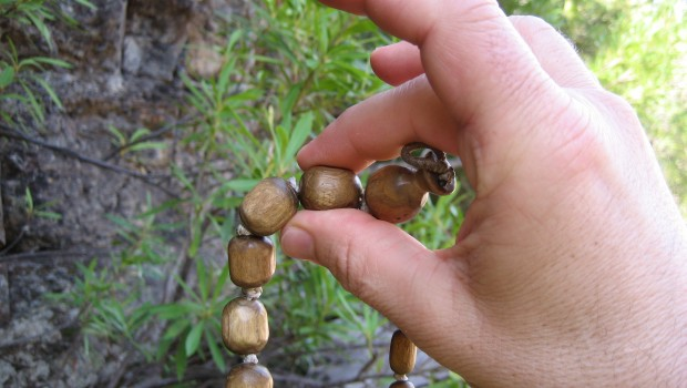 Chanting Hare Krishna on Beads