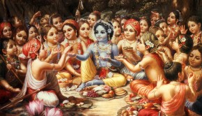 Krishna surrounded by His cowherd boyfriends sitting in the forest of Vrindavan at lunch time