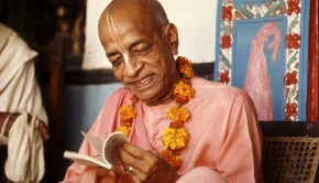 Srila Prabhupada inspects small book from one of his godbrothers