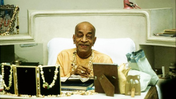 Srila Prabhupada smiling at his desk in Vrindavan