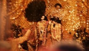 Srila Prabhupada fans Krishna Balaram Deities with Peacock Fan