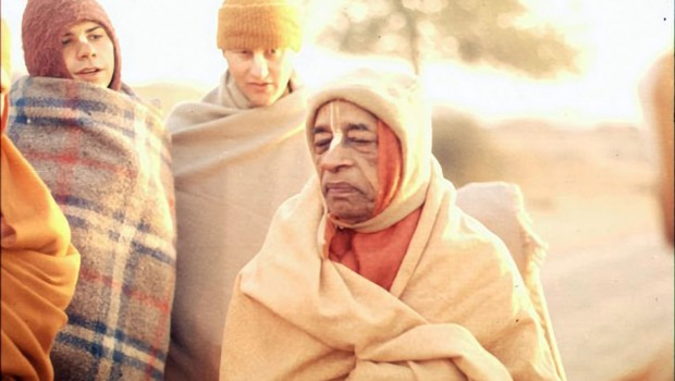 Srila Prabhupad and disciples on a morning walk on a cold morning