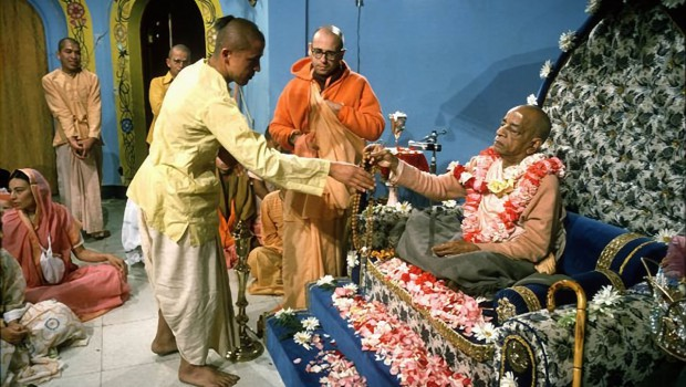 Srila Prabhupada Hands Japa Beads to South American Disciple at Initiation Ceremony