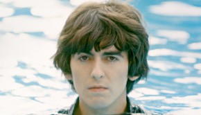 George Harrison in water up to his neck