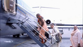 Srila Prabhupada climbing up ladder to airplane