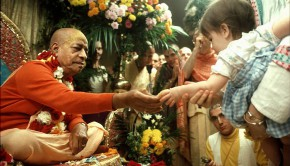 Srila Prabhupada distributes cookie prasadam to devotee child