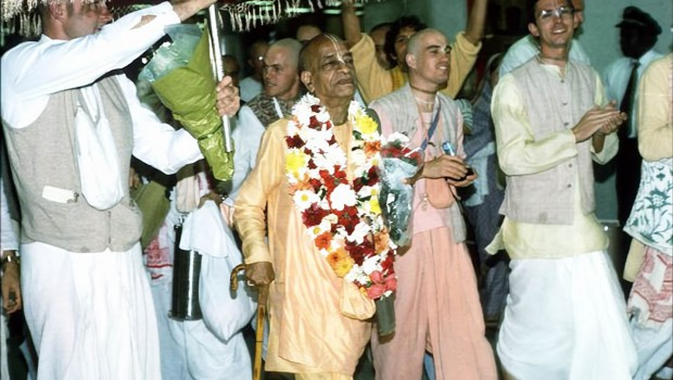 Srila Prabhupada with disciples walking down airport passage