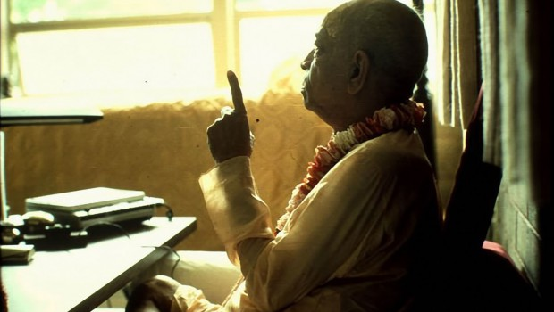Srila Prabhupada preaching and pointing with his finger