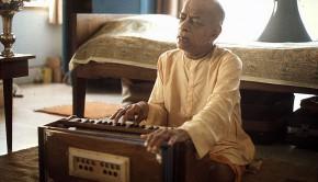 Srila Prabhupada plays harmonium and sings bhajan