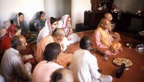 Srila Prabhupada sitting on floor with his disciples