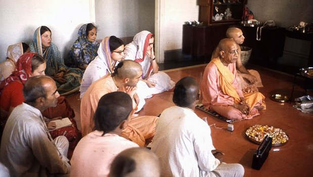 Srila Prabhupada sitting on floor with his disciples