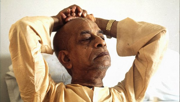 Srila Prabhupada with hands behind head