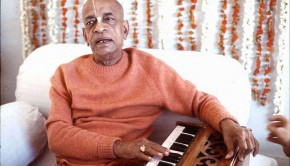 Srila Prabhupada playing harmonium and chanting