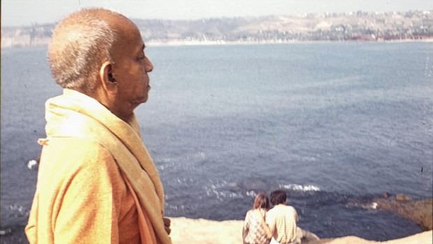 Srila Prabhupada walking by the ocean