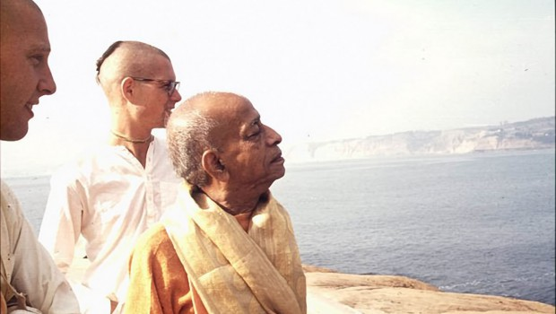 Srila Prabhupada and disciples looking out to sea