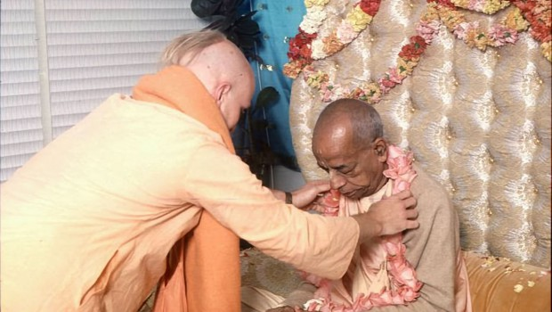 Disciple offers Srila Prabhupada a Flower Garland