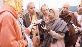 Srila Prabhupada having an animated discussion with disciples during a morning walk