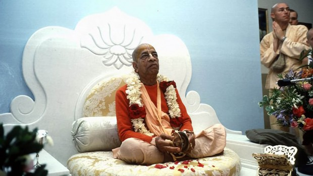 Srila Prabhupada playing kartals on white vyassasana