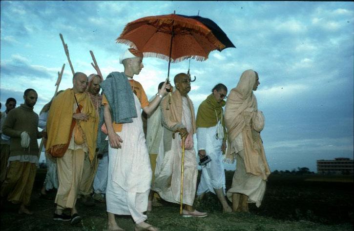 Srila Prabhupada Walking with Disciples at Sunrise