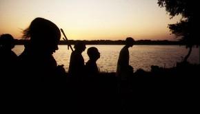 Srila Prabhupada and Disciples on Morning Walk beside lake at sunrise