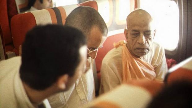 Srila Prabhupada and disciples on airplane