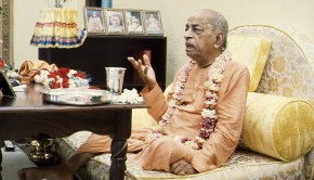 Srila Prabhupada preaches to a guest in his room