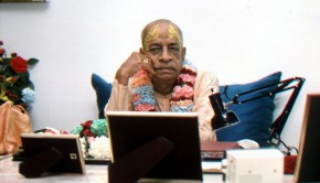 Srila Prabhupada Looking at a Photo of the Deities