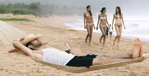 Bikini girls on a beach in Goa, India